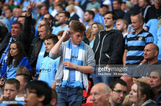 GESTURE*** Manchester City fans appear dejected in the stands during the Community Shield match at Wembley Stadium London