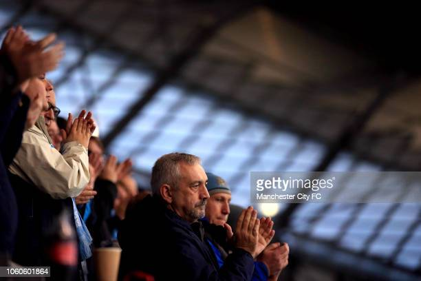 Manchester City fans are seen during commemoration of Remembrance Sunday ahead of the Premier League match between Manchester City and Manchester...