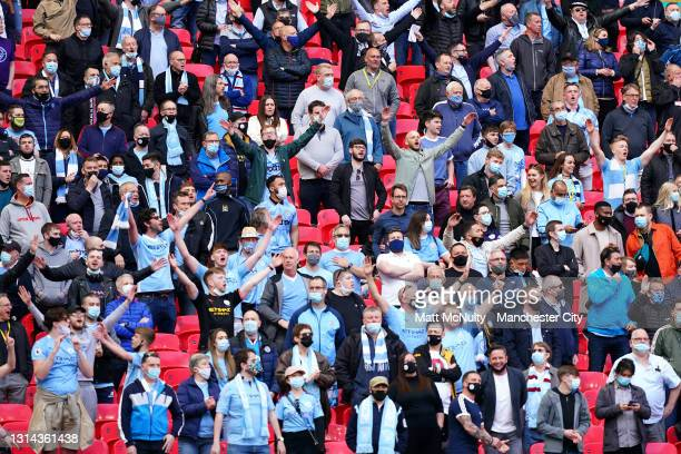 Manchester City fans are seen singing in full voice during the Carabao Cup Final between Manchester City and Tottenham Hotspur at Wembley Stadium on...