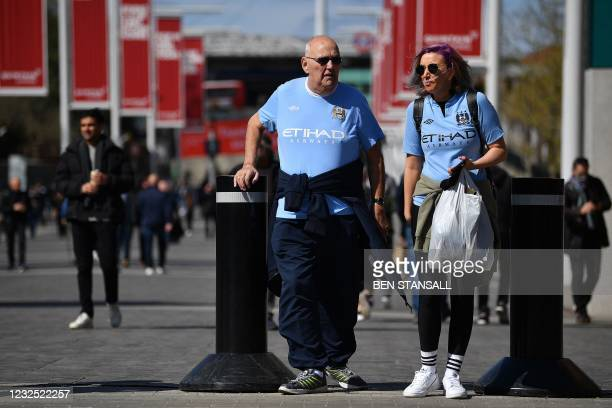 Manchester City fans arrive at Wembley Stadium to watch the English League Cup final football match between Manchester City and Tottenham Hotspur, in...