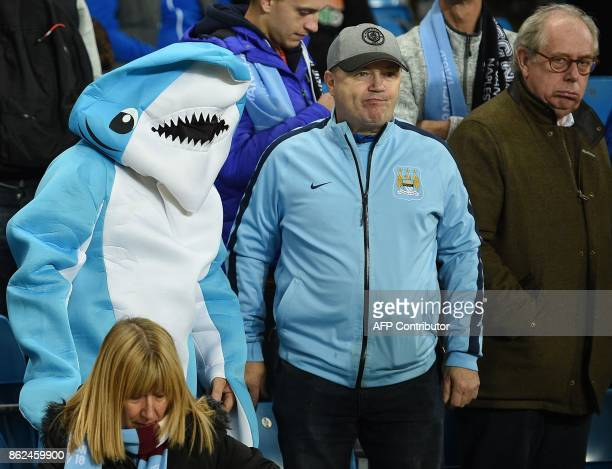 Manchester City fans await the start of the UEFA Champions League Group F football match between Manchester City and Napoli at the Etihad Stadium in...