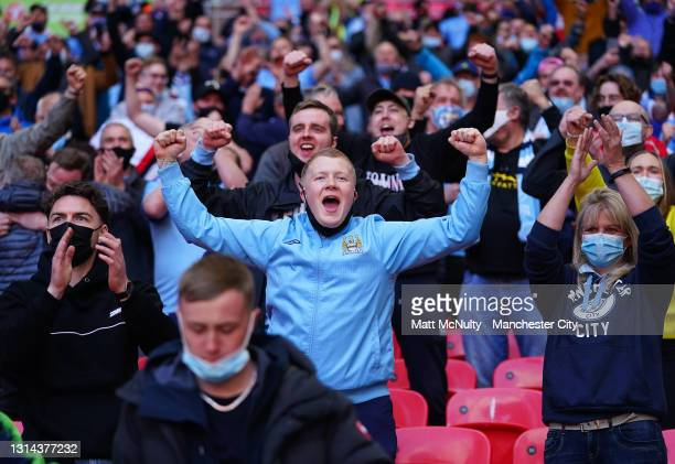 Manchester City fans celebrate after the Carabao Cup Final between Manchester City and Tottenham Hotspur at Wembley Stadium on April 25, 2021 in...