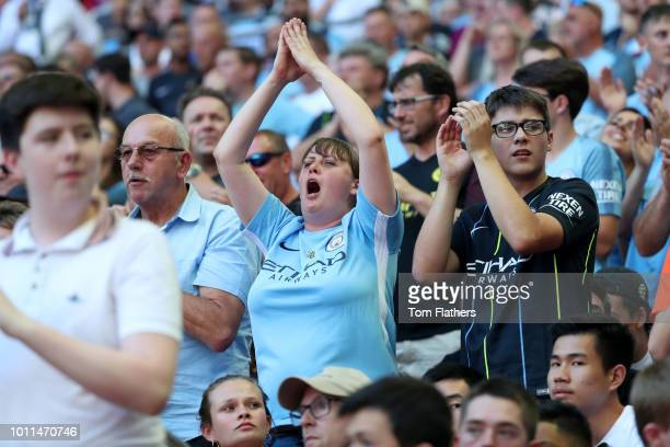 Manchester City fans celebrate during the FA Community Shield between Manchester City and Chelsea at Wembley Stadium on August 5 2018 in London...