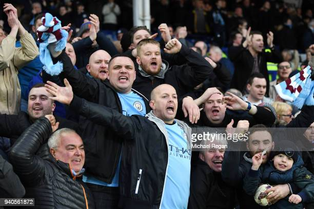 Manchester City fans celebrate during the Premier League match between Everton and Manchester City at Goodison Park on March 31 2018 in Liverpool...