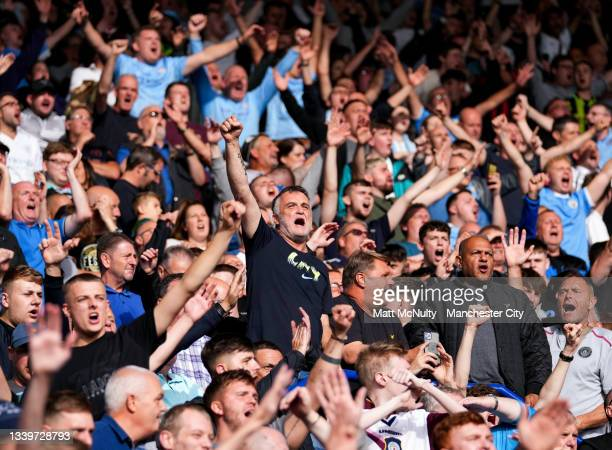 Manchester City fans celebrate during the Premier League match between Leicester City and Manchester City at The King Power Stadium on September 11,...