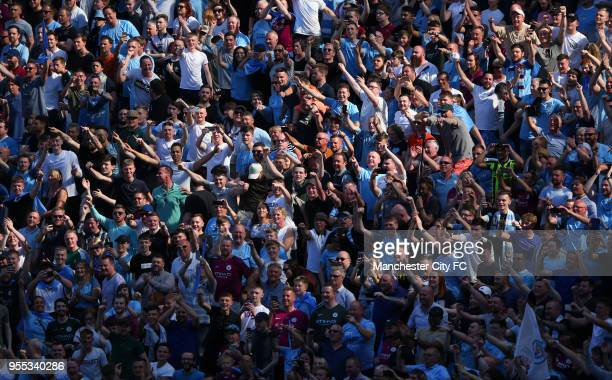 Manchester City fans celebrate during the Premier League match between Manchester City and Huddersfield Town at Etihad Stadium on May 6 2018 in...
