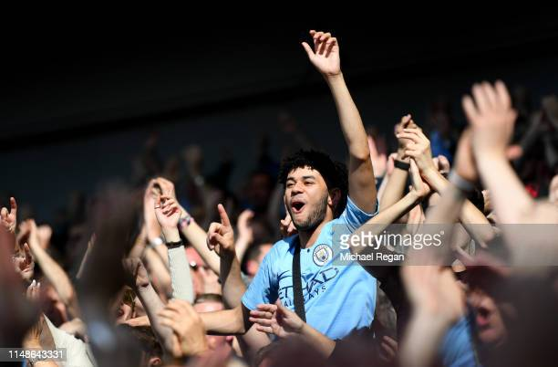 Manchester City fans celebrate during the Premier League match between Brighton Hove Albion and Manchester City at American Express Community Stadium...