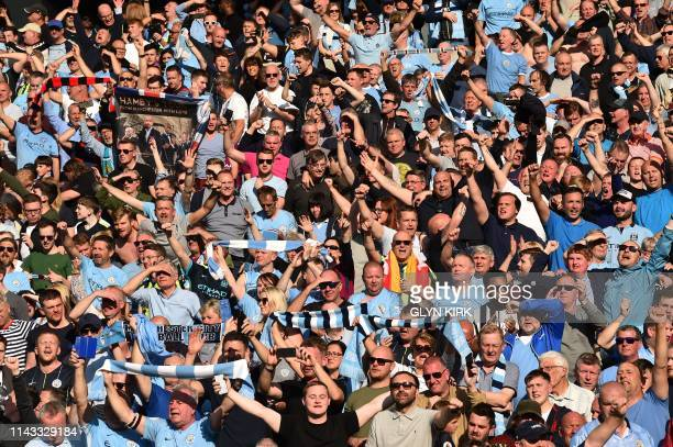 Manchester City fans celebrate in the crowd after winning the Premier League title following their 41 victory in the English Premier League football...