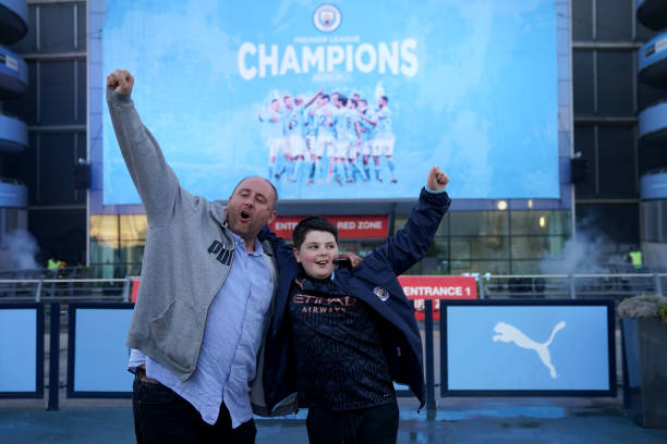 GBR: Manchester City Fans Celebrate Winning the Premier League Title