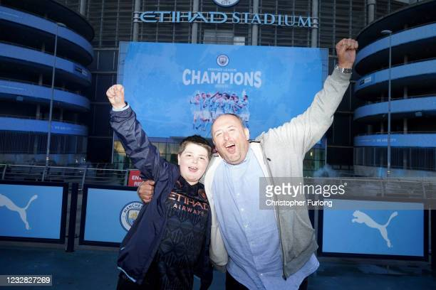Manchester City fans celebrate outside Etihad Stadium as their team has been confirmed as Premier League champions for the third time in four seasons...