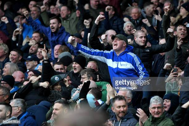 Manchester City fans celebrate their first goal during the Premier League match between Everton and Manchester City at Goodison Park on March 31 2018...