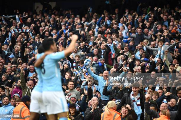 Manchester City fans celebrate their sides second goal during the Premier League match between Manchester City and Manchester United at Etihad...