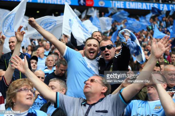 Manchester City fans celebrate victory after the FA Cup Final match between Manchester City and Watford at Wembley Stadium on May 18 2019 in London...