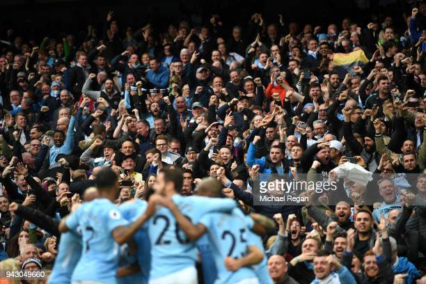 Manchester City fans celebrates after their sides first goal during the Premier League match between Manchester City and Manchester United at Etihad...