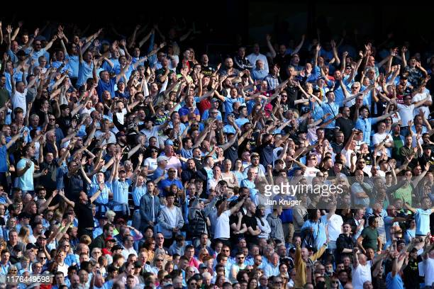 Manchester City fans cheer during the Premier League match between Manchester City and Watford FC at Etihad Stadium on September 21 2019 in...