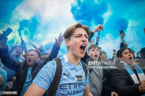 Manchester City fans cheer on their players as they welcome them ahead of the Premier League match between Manchester City and Everton at Etihad...
