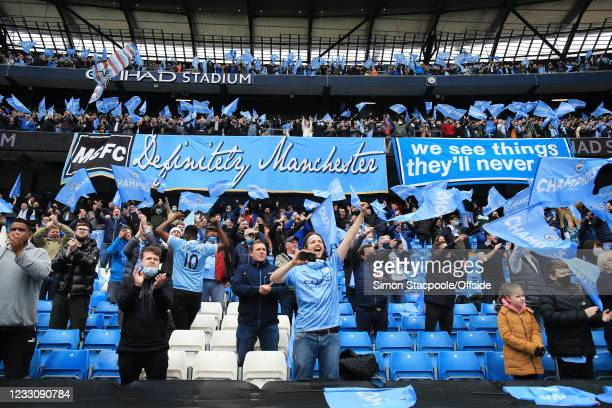 Manchester City fans cheer their side on during the Premier League match between Manchester City and Everton at Etihad Stadium on May 23, 2021 in...