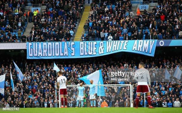 Manchester City fans display a banner prior to the Premier League match between Manchester City and Burnley at Etihad Stadium on October 21 2017 in...