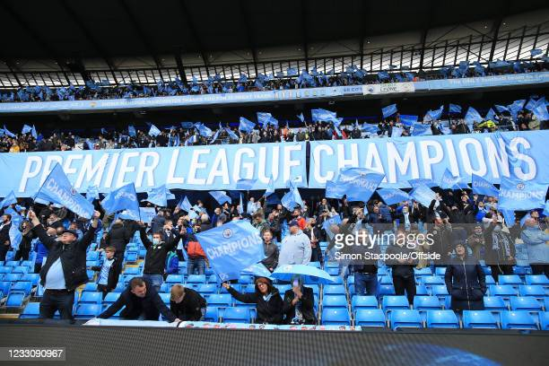 Manchester City fans display a banner proclaiming themselves Champions before the Premier League match between Manchester City and Everton at Etihad...