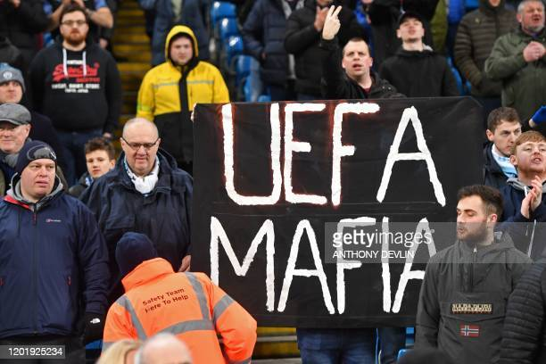 Manchester City fans display an anti-Uefa banner in the crowd ahead of the English Premier League football match between Manchester City and West Ham...