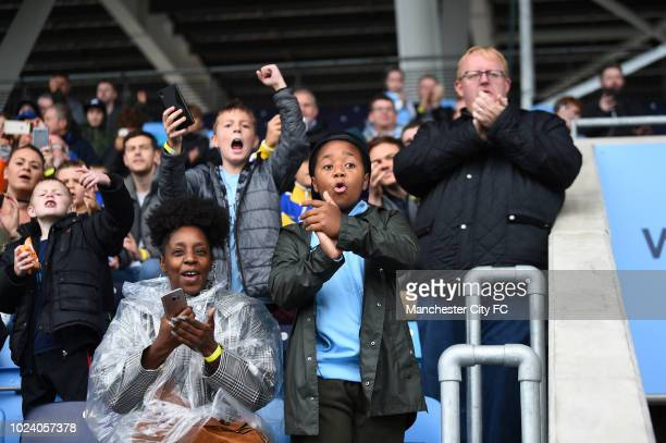 Manchester City fans during a open training session at Manchester City Football Academy on August 26 2018 in Manchester England
