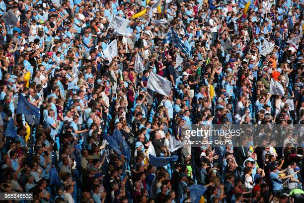 Manchester City fans enjoy the atmosphere during the Premier League match between Manchester City and Huddersfield Town at Etihad Stadium on May 6...