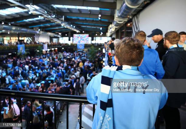 Manchester City fans enjoy the pre match atmosphere ahead of the Carabao Cup Final between Chelsea and Manchester City at Wembley Stadium on February...