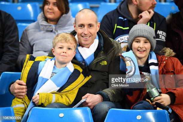 Manchester City fans enjoy the pre match atmosphere as they await kick off prior to the Premier League match between Manchester City and...