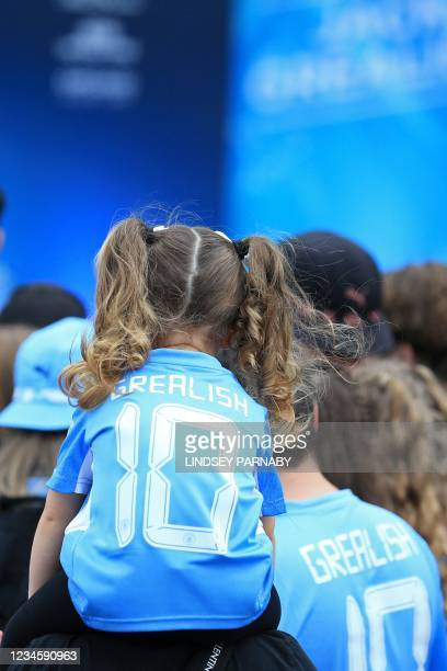 Manchester City fans gather outside the Etihad Stadium ahead of the unveiling of new signing, Jack Grealish in Manchester, north-west England on...