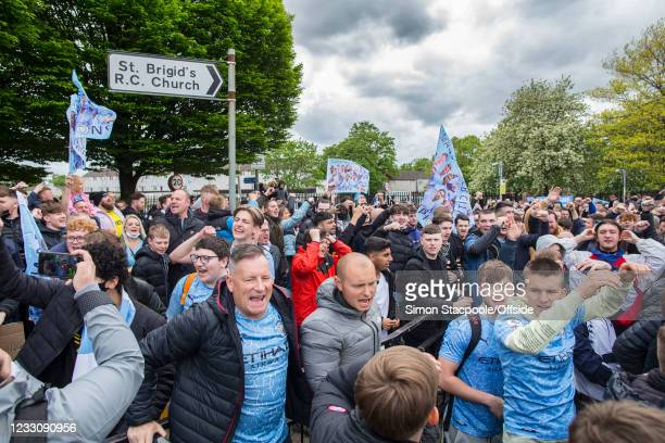 Manchester City fans gather together before the Premier League match between Manchester City and Everton at Etihad Stadium on May 23, 2021 in...