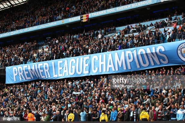 Manchester City fans hold a champions banner during the Premier League match between Manchester City and Swansea City at Etihad Stadium on April 22...