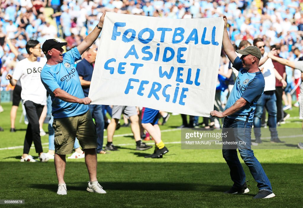 Manchester City fans hold up a banner aimed at Sir Alex Ferguson during the Premier League match between Manchester City and Huddersfield Town at Etihad Stadium on May 6, 2018 in Manchester, England.