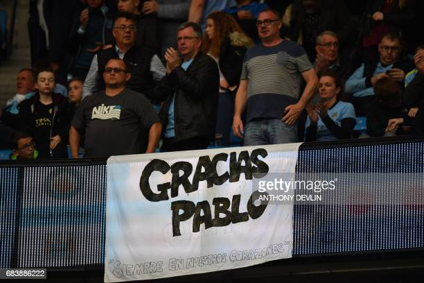 Manchester City fans hold up a banner in tribute to Manchester City's Argentinian defender Pablo Zabaleta during the English Premier League football...