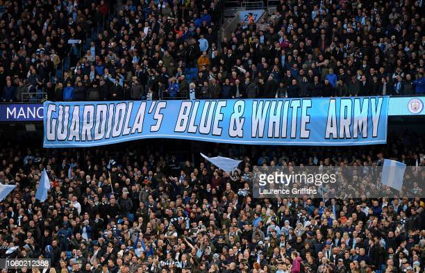 Manchester City fans hold up a banner prior to the Premier League match between Manchester City and Manchester United at Etihad Stadium on November...