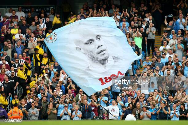 Manchester City fans hold up a Vincent Kompany of Manchester City banner during the Premier League match between Manchester City and Newcastle United...