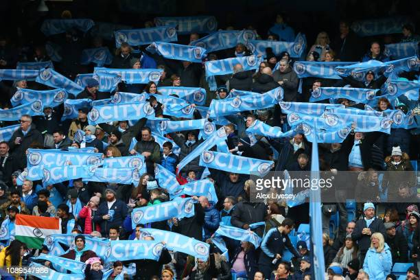 Manchester City fans hold up scarfs prior to the FA Cup Fourth Round match between Manchester City and Burnley at Etihad Stadium on January 26 2019...
