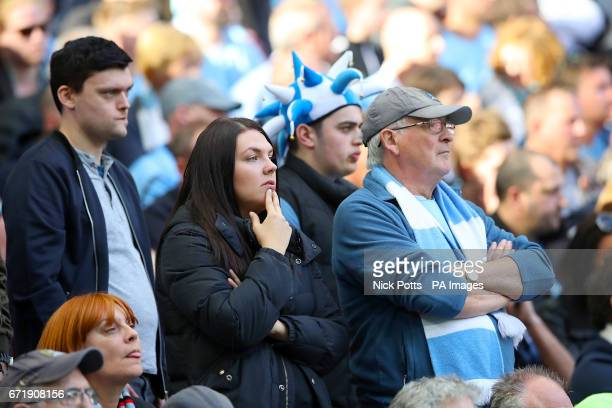 Manchester City fans look dejected in the stands as their side concede during extras time during the Emirates FA Cup Semi Final match at Wembley...
