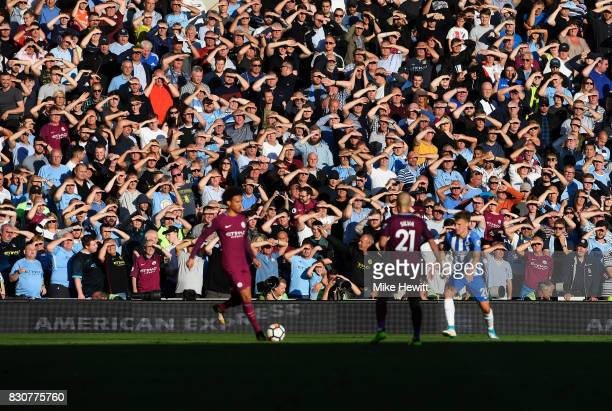Manchester City fans look on during the Premier League match between Brighton and Hove Albion and Manchester City at the Amex Stadium on August 12...