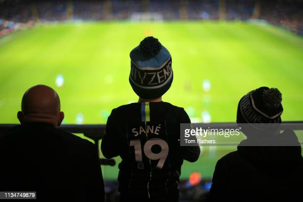 Manchester City fans look onduring the Premier League match between Manchester City and Watford FC at Etihad Stadium on March 09 2019 in Manchester...