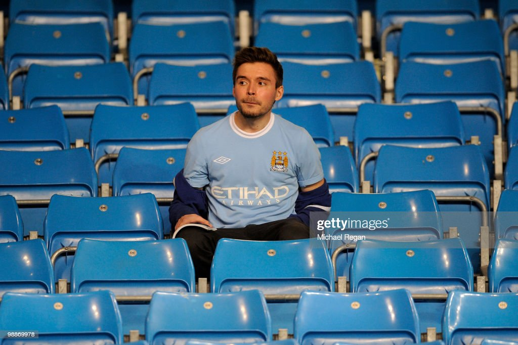 A Manchester City fans looks dejected at the end of the Barclays Premier League match between Manchester City and Tottenham Hotspur at the City of Manchester Stadium on May 5, 2010 in Manchester, England.