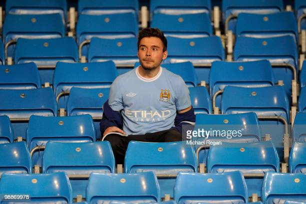 Manchester City fans looks dejected at the end of the Barclays Premier League match between Manchester City and Tottenham Hotspur at the City of...