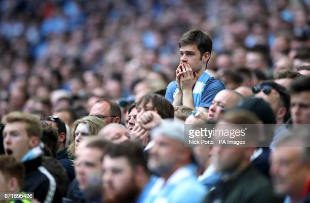 Manchester City fans show dejection after Arsenal equalise during the Emirates FA Cup Semi Final match at Wembley Stadium London