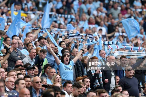 Manchester City fans show their support during the FA Cup Final match between Manchester City and Watford at Wembley Stadium on May 18 2019 in London...