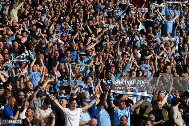 Manchester City fans show their support following the Premier League match between Brighton Hove Albion and Manchester City at American Express...