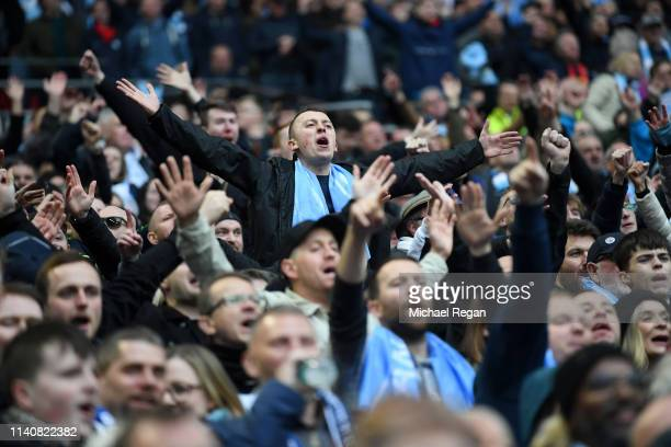 Manchester City fans surport there team during the FA Cup Semi Final match between Manchester City and Brighton and Hove Albion at Wembley Stadium on...