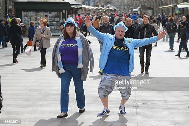 Manchester City fans walk along Las Ramblas ahead of the UEFA Champions League Round of 16 match between Barcelona and Manchester City at Camp Nou on...