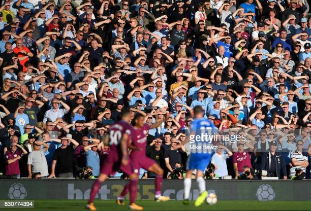 Manchester City fans watch the game during the Premier League match between Brighton and Hove Albion and Manchester City at the Amex Stadium on...