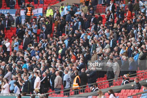 Manchester City fans watch the game from the stands during the Carabao Cup Final between Manchester City and Tottenham Hotspur at Wembley Stadium on...