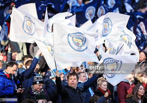 Manchester City fans wave flags during the Carabao Cup Final between Aston Villa and Manchester City at Wembley Stadium on March 01 2020 in London...