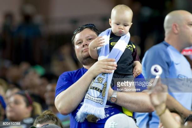 Manchester City father with his son showing hid support for prior to the Premier Soccer League game between Manchester United and the Manchester City...